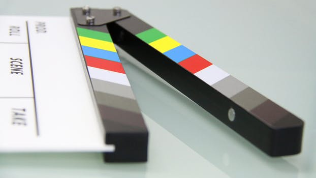 Film clapperboard lying on one side on a table