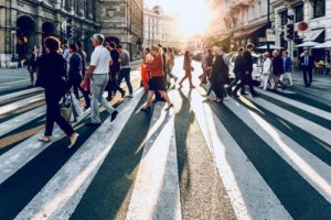 Image of people crossing zebra crossing over the high street for shopping